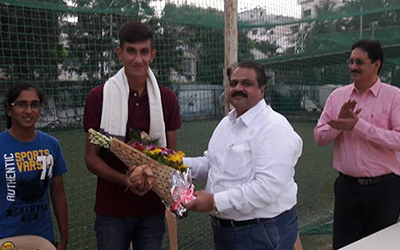 Mr. Chintamani Nimhan (Chairman , Sanjay Sports Academy) felicitating Master. Yatin Mangwani for getting Selected in the U-19 Indian Cricket Team